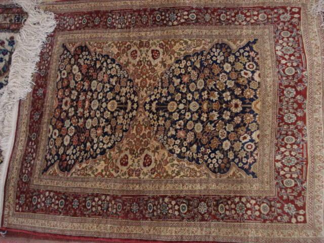 A Hereke silk rug, West Anatolia, 97cm x 76cm
