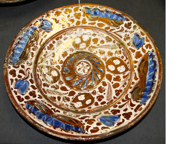 A Valencia (Manises) earthenware dish and another similar, circa 1500-1525 and 1525-60 and a group of other 18th century Hispano-Moresque pottery dishes,