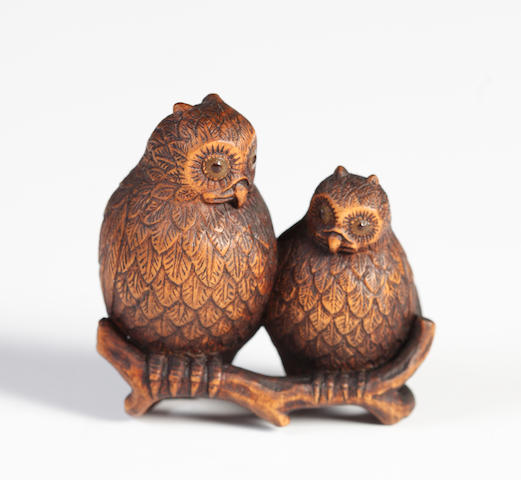 A wood netsuke of two owls