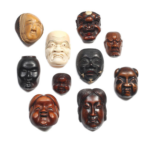 Seven wood netsuke Noh mask subjects Three signed: Hidenao; Masamitsu and Masatsugu.