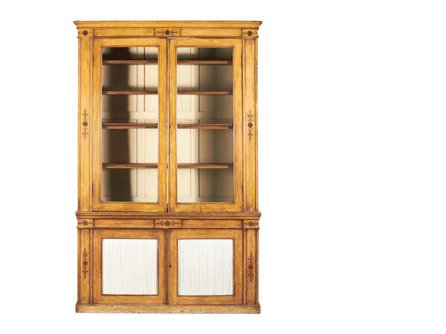 A second quarter 19th century and later painted bookcase in the Charles X style