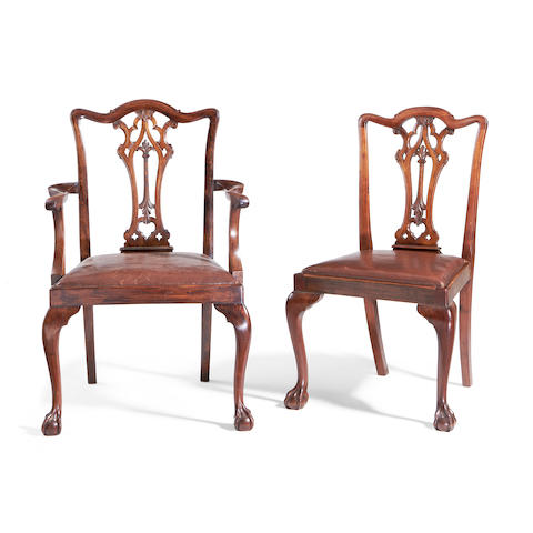 A set of ten second quarter 20th century mahogany dining chairs in the George II style