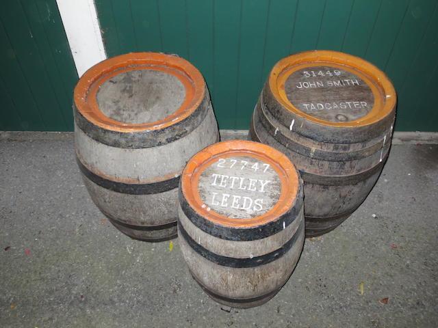 Three wooden beer barrels,
