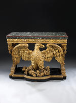 A pair of George II style carved giltwood console tables in the manner of William Kent