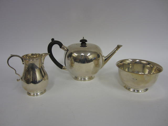 A silver three-piece tea service various dates and makers marks