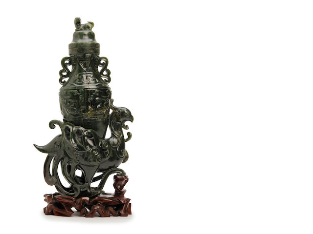 A spinach-green jade phoenix vase and cover  19th Century