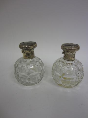 A pair of silver, tortoiseshell and glass scent bottles London 1917  (2)