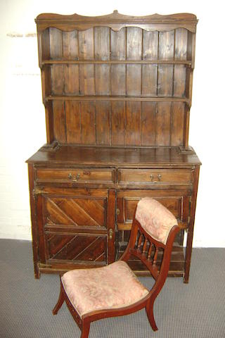 An early 20th century stained pine dresser