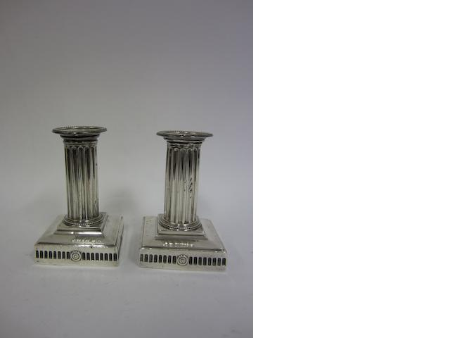 A Victorian pair of silver column candlesticks J.R.B, Sheffield 1888