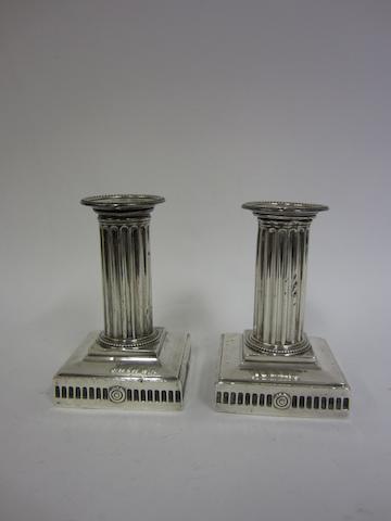 A Victorian pair of silver column candlesticks J.R.B, Sheffield 1888