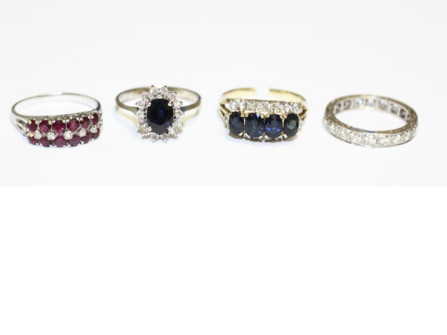 Four gem set rings, (4)