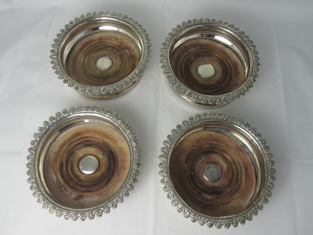 A set of four Sheffield plate wine coasters Circa 1830  (4)