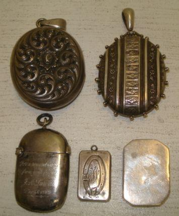A George III plain rectangular silver vinaigrette, possibly by Thomas Holland, 1802, with canted corners, gilt lined, 3cm, an Edwardian silver vesta case, Birmingham 1902, inscribed, a large Victorian oval silver locket, Birmingham 1881, the hinged front with foliate and lozenge bands, another similar, the hinged front embossed with flowerheads and leaves, the back with leaf scrolls, a small Victorian rectangular silver box, makers mark G W D, Birmingham 1880, with ring attachment, monogramed and other items.