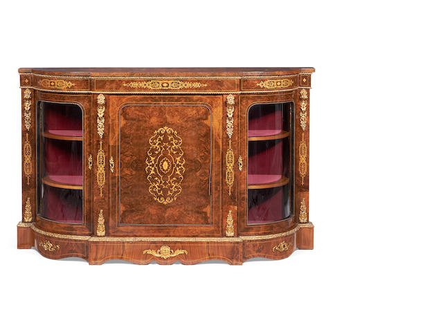 A mid Victorian gilt metal mounted burr walnut and fruitwood inlaid credenza