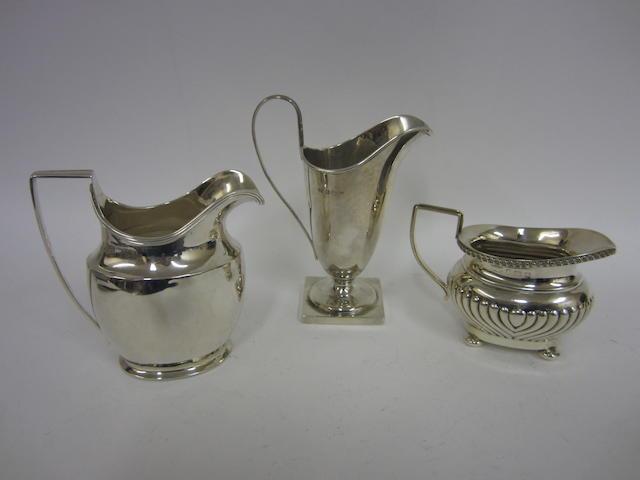 An Edwardian silver helmet shape cream jug Birmingham 1904  (3)