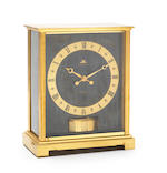Jaeger-LeCoultre. A gilt brass barometrically wound mantle clockAtmos Embassy, Circa 1970