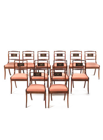 A set of twelve 19th century mahogany dining chairs in the Regency style