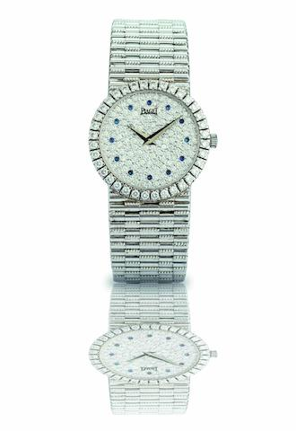 Piaget. A fine 18ct white gold, sapphire and diamond set lady's quartz bracelet watch Ref:8706 G 2, Case No.610940, Movement No.192021, Circa 2000s