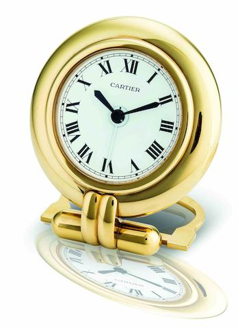 Cartier. A fine gilt brass alarm quartz desk clockLes Must de Cartier, Case No.0542582, Circa 1992