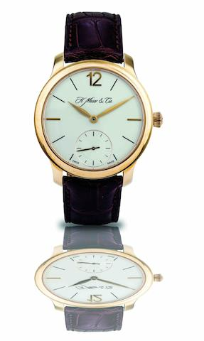 H. Moser & Cie. A fine 18ct rose gold manual wind wristwatch with power reserve Mayu, Ref.321.503-005, Case No.200 102964, Circa 2011