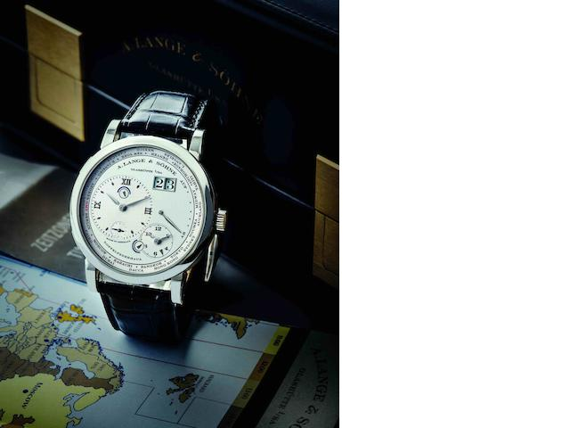 A. Lange & Söhne. A very fine PT950 platinum manual wind calendar wristwatch with power reserve indication and world time display Lange 1 Time Zone, Ref.116.025, Case No.160520, Movement No.50661, Circa 2008