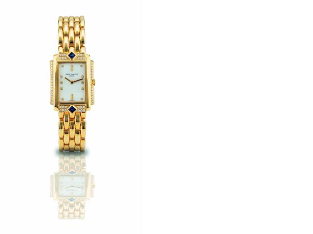 Patek Philippe. A fine and rare 18ct gold, sapphire and diamond set lady's quartz bracelet watchRef:4843/11, Case No.1627889, Movement No.2984236, Sold 7th February 1998