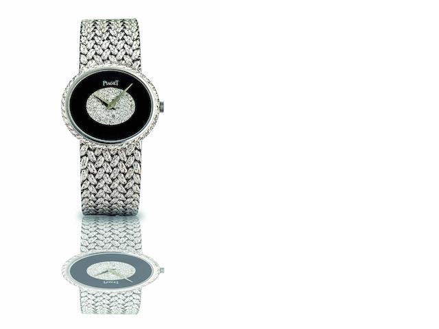 Piaget. A fine and rare 18ct white gold, onyx and diamond set lady's manual wind bracelet watch Case No.9802 D 2 322201, Movement No.7806843, Circa 1970s