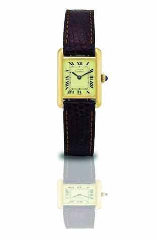 Cartier. A fine gold plated silver lady's manual wind wristwatch Tank Vermeil, Circa 1980