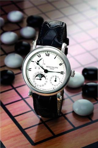 Patek Philippe. A very fine and rare PT950 platinum calendar automatic wristwatch with moon phases and power reserve indicationRef:5054P, Case No.4084590, Movement No.3112352, Sold in 2000