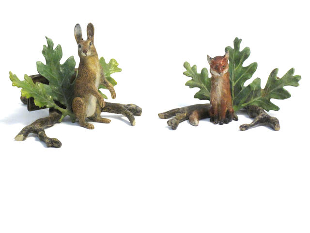 A pair of early twentieth century cold painted bronze menu holders