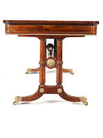 A Regency rosewood and brass inlaid library table in the manner of Gillows