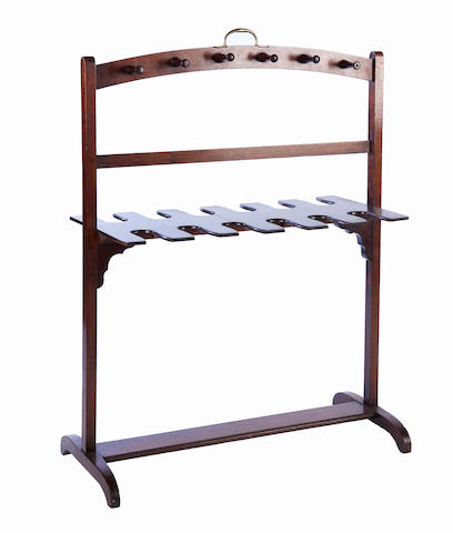 A 19th century mahogany whip and boot rack