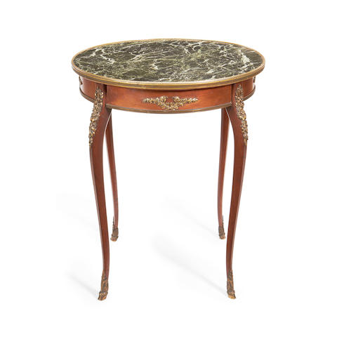A small French late 19th/early 20th century brass mounted mahogany centre table in the Louis XVI style