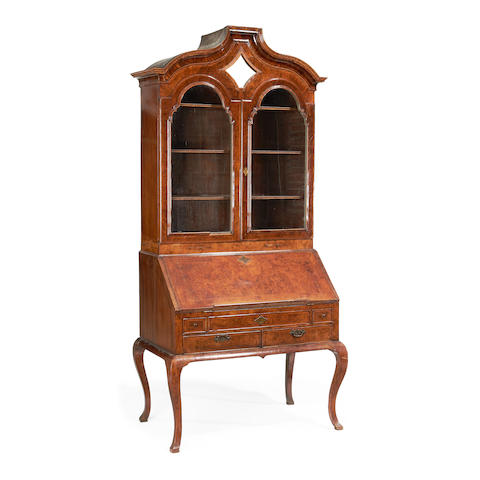 A George I walnut and featherbanded bureau cabinet