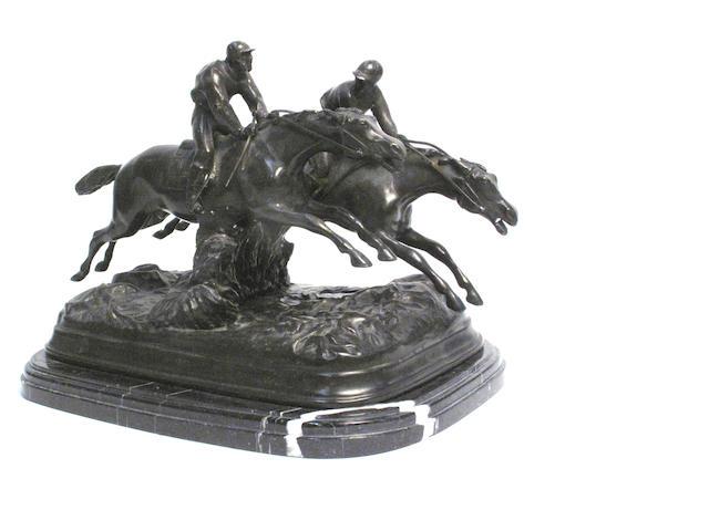 A bronze horse racing scene