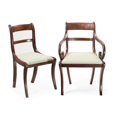 A set of eight Regency mahogany and brass strung dining chairs, including a pair of armchairs