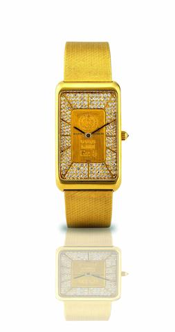 Corum. A fine and rare 18ct gold and diamond set wristwatch incorporating a 999.9 gold ingot bracelet watchRef:44485B 10, Case No.361773, Movement No.205392, Circa 1980s