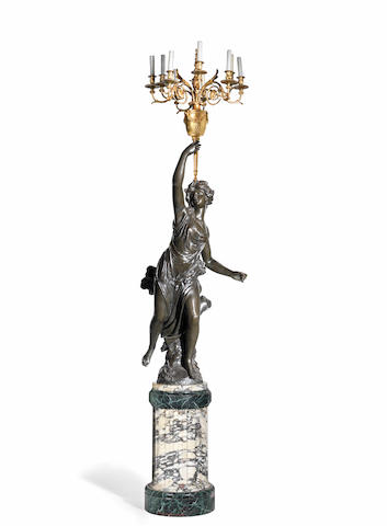 A very large patinated and gilt bronze figural candelabra, France, circa 1880 raised on a marble and scagliola base