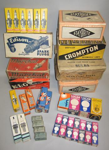 A collection of new/old stock spark plugs and bulbs,