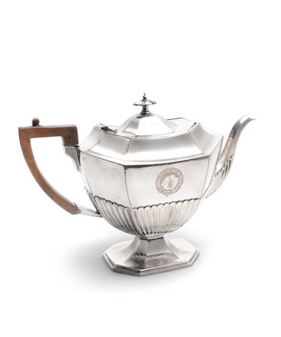 DISOVERY An electroplated silver teapot with wooden handle, [c.1901]