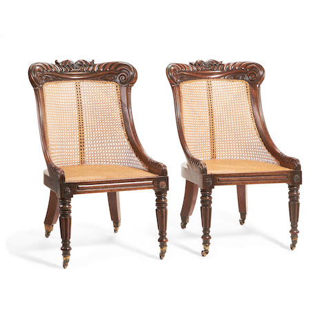 A pair of George IV walnut caned library chairs