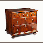 A late 17th Century walnut veneered chest