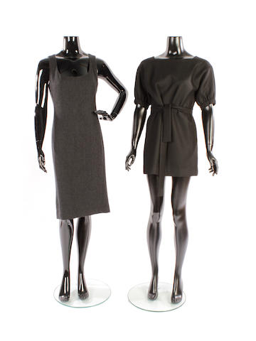 A group of four designer black and grey dresses