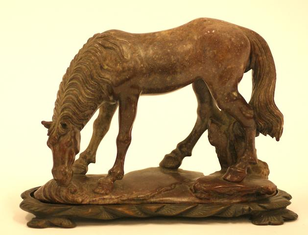 A 19th century Chinese soapstone carving of a horse, carved wooden base