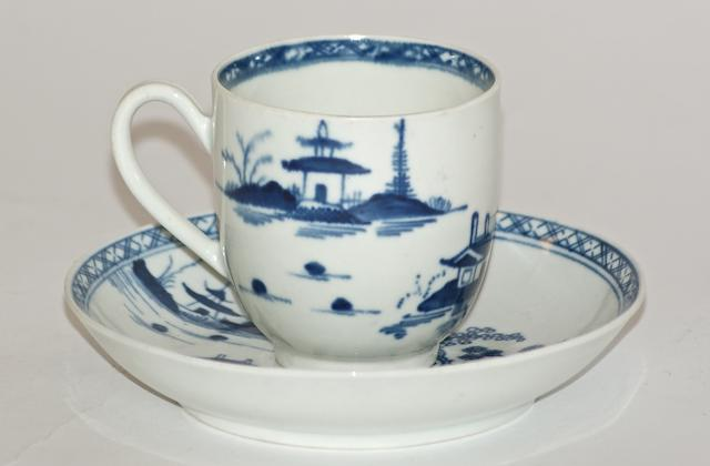 A Worcester porcelain coffee cup and saucer, circa 1770