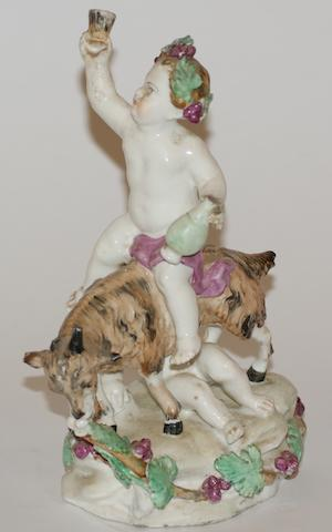 A Bow porcelain figure group of two putti playing with a goat, circa 1770