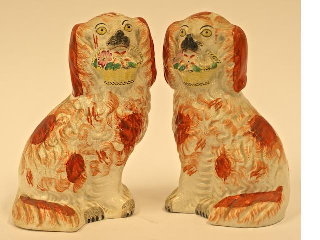 A pair of Victorian Staffordshire seated poodles