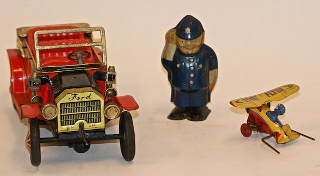 A Vintage tinplate clockwork Model T Ford