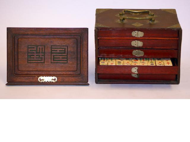 A bone and bamboo Mah-jong set in fire drawer wooden carry case