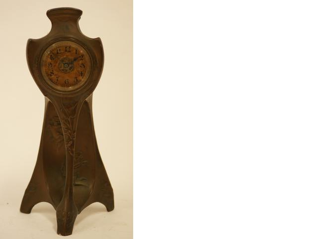 An Art Nouveau bronze mantel clock